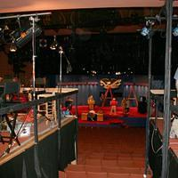 setting up network platforms in the back of the debate hall, stage in the distance