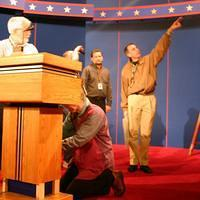 the debate director on stage Tuesday, pointing at something