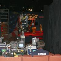 control gear and monitors next to the NBC debate hall platform, stage in the distance