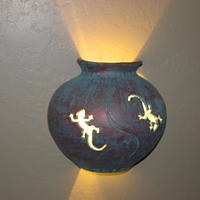 This is a less artsy picture of the Gecko light.  It's a copper-like finish.